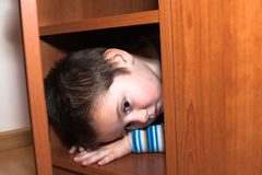 Scared child hiding Stock Images