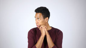 Scared and Confused Afro-American Man feeling Uncomfortable Stock Photo
