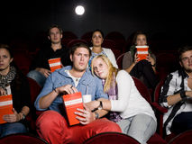Scared couple at cinema Royalty Free Stock Images