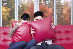 Scared couple watching halloween movie Royalty Free Stock Images