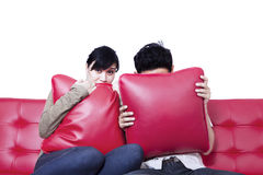 Scared Couple Watching Horror Movie Stock Photo