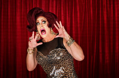 Scared Drag Queen. With hands up in theater Royalty Free Stock Photos