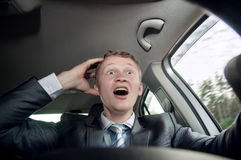 Scared, the driver behind the wheel of of the car Royalty Free Stock Photos