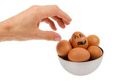 Scared egg, waiting to be grabbed by a hand Royalty Free Stock Image
