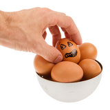 Scared egg, waiting to be grabbed by a hand Royalty Free Stock Photos