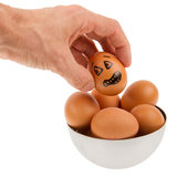 Scared egg, waiting to be grabbed by a hand Royalty Free Stock Images