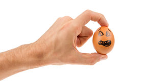 Scared egg, waiting to be grabbed by a hand Stock Image