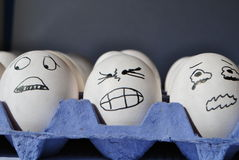Scared eggs Stock Images