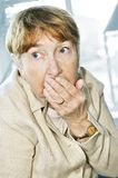 Scared elderly woman stock image