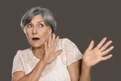 Scared elderly woman Royalty Free Stock Photos