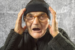 Scared elderly woman. Royalty Free Stock Photos