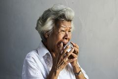 A scared elderly woman is screaming Royalty Free Stock Image