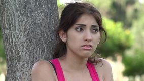 Scared fearful young female. A young hispanic adult female stock video footage