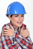 Scared female builder. Doesn't know what she's doing Stock Photo