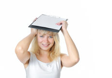 Scared female caucasian holding blank book Royalty Free Stock Images
