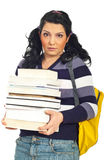 Scared female student with books. Student female holding stack of books and being scared and surprised  isolated on white background Stock Photography