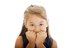 Scared girl biting her nails. Scared little girl biting her nails Stock Photo