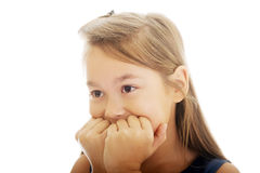 Scared girl biting her nails Stock Image