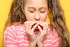 Scared girl closed eyes cover mouth hands stress stock photo