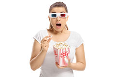 Scared girl with 3D glasses and popcorn Royalty Free Stock Photos