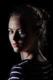 Scared girl in dark Stock Images