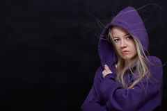 Scared girl in hood Royalty Free Stock Image