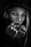Scared girl in hood Royalty Free Stock Photography