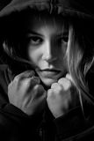 Scared girl in hood Stock Photography