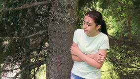 Scared girl lost in forest stock video