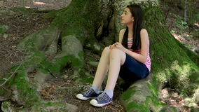 Scared girl lost in forest stock footage