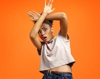 Scared girl outstretched her palms, hiding her face. stock images