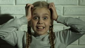 Scared girl screaming holding head with hands, psychological trauma, nightmare. Stock footage stock video footage