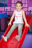 Scared girl on slide Royalty Free Stock Images