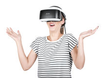 Scared girl in VR goggles and playing virtual reality game, isolated on a white background. A smartphone using with VR headset. stock images