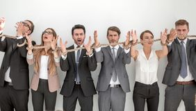 Scared group of business people tied with a rope. royalty free stock image