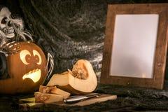 Scared pumpkin watching on  cuted other pumpkin Stock Photos