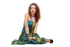 Scared hippie girl sitting on the ground Stock Photos