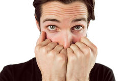 Scared hipster with hands to face Royalty Free Stock Image