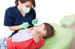 Scared kid with fear of dentist covering mouth Royalty Free Stock Image