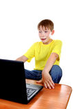 Scared Kid with Laptop Stock Photography