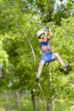 Scared Kid on Zip Line. Summer day royalty free stock image