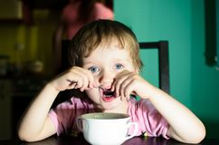 Scared little boy eating Stock Photography
