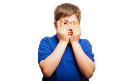Scared little boy peeking Stock Photo