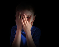 Scared Little Child Covering Eyes on Black Royalty Free Stock Photos