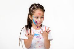 Little child girl with hands painted in colorful paint stock photography