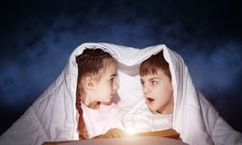 Scared little girl and boy looking at each other royalty free stock photo
