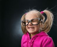 Scared little girl in funny big spectacles Royalty Free Stock Photo
