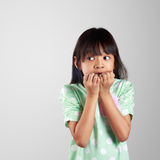 Scared little girl hiding face. On grey background with clipping path Stock Photo