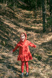 Scared little girl in the woods Royalty Free Stock Photo