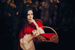 Scared Little Red Riding Hood Hiding in the Forest Stock Image